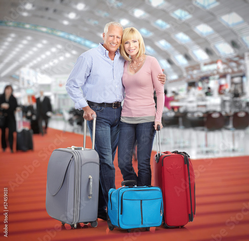 Senior couple in airport.