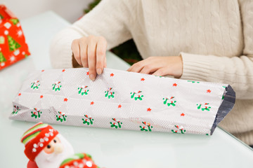 Woman Wrapping Christmas Gift