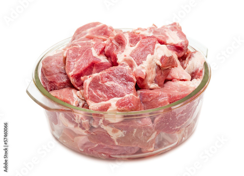 Pieces of fresh raw meat in glass pan