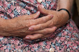 Senior woman holding her hands together