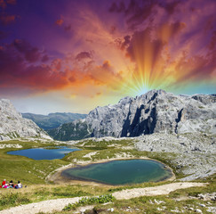 Beautiful lakes and peaks of Dolomites. Summer sunset over Alps
