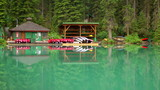 Serene scene of boat house on Emerald Lake in Yoho National Park