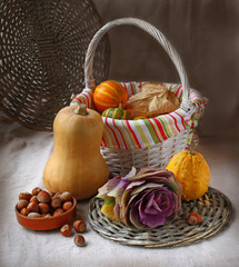 Basket with pumpkins and hazelnuts