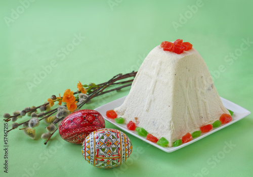 Curd paskha (pacha) , decorative Easter eggs and bunch of willow