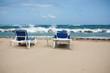 group of deckchairs on the calm beach