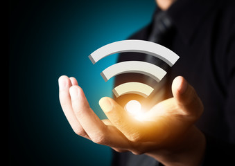 Wifi technology symbol in businessman hand