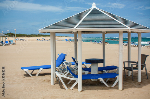 sunny calm beach with deckchairs