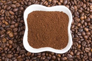 grounds coffee on coffee beans background