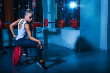 Horizontal photo of pretty sports woman in gym
