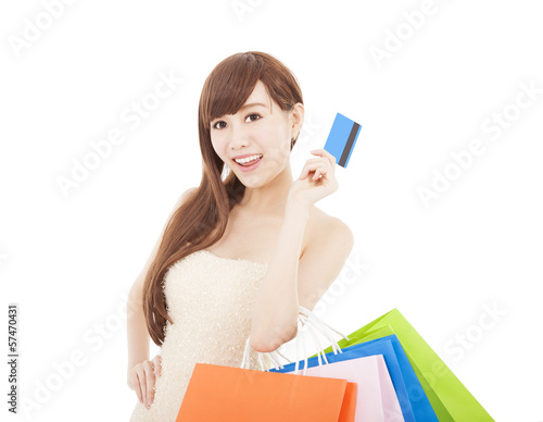 happy woman with credit card and shopping bags