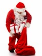 Santa Claus with christmas sack and gift boxes