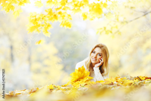 Woman laying in autumn park