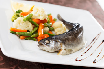 trout served with mixed vegetables