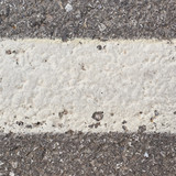White paint stripe on asphalt