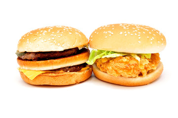 Two large burgers on a white background
