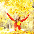 Happy woman in autumn park