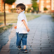 Young boy walking in the park portrait.