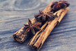 Star anise and cinnamon on a wooden background
