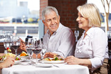 Two seniors eating out in restaurant