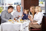 Happy family smiling together in restaurant