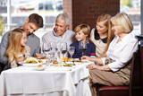Happy family eating in restaurant