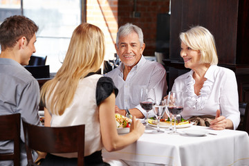 Couple with family in a restaurant