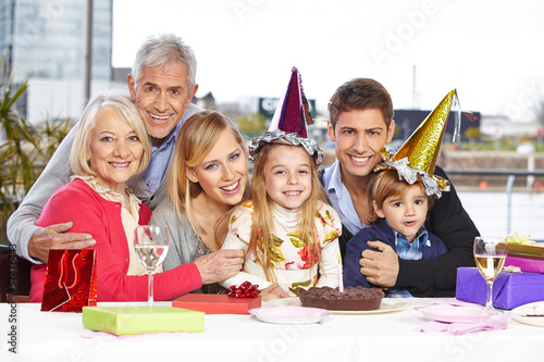 Siblings celebrating birthday together with family