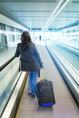 Woman on the airport with luggage