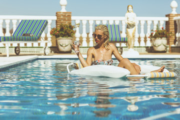 Blonde girl relaxing in pool