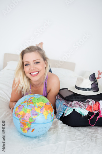 Student with a suitcase and a globe
