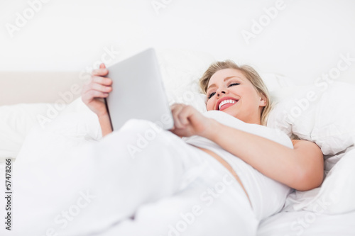 Woman laughing while using an ebook reader