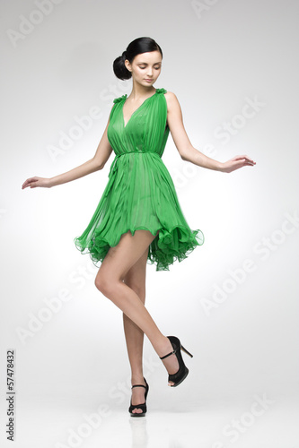 brunette in green dress