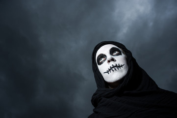 scary skull woman cloudy skies