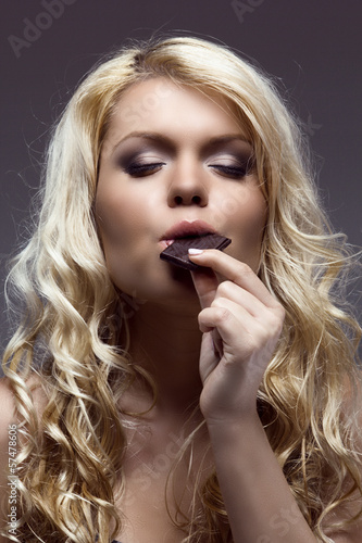 young blonde enjoys the chocolate