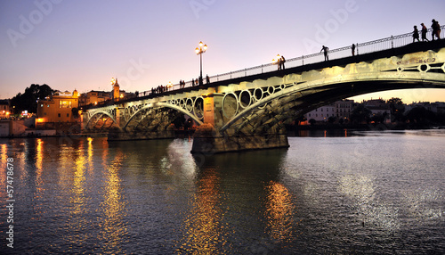 Triana Bridge at dusk, Seville, Spain