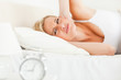 Unhappy woman awaked by her alarm clock