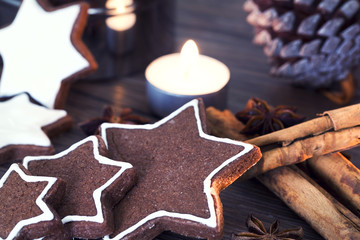 Cookies, star anise, cinnamon, candle