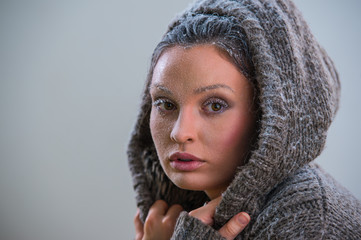 Portrait of beautiful girl with frost on face