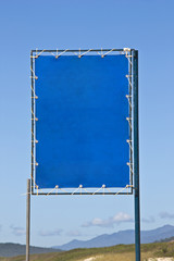Blue beach sign