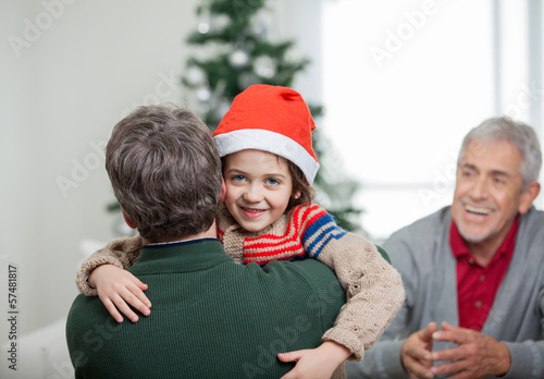 Happy Boy Embracing Father During Christmas