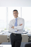 Portrait of confident businessman with arms crossed in office