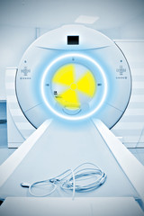 Radiation Sign on a background of CT machines.