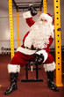 Santa Claus training before Christmas with kettlebells