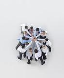 Business people joining hands in huddle