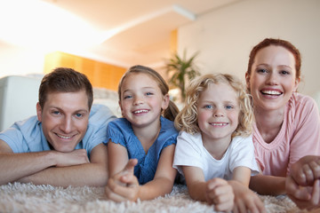 Happy family on the carpet