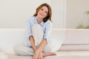 Mature woman on couch