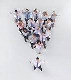 Portrait of gesturing business people forming pyramid with boss in front