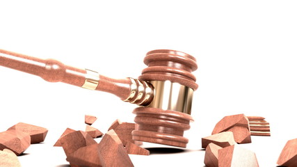 gavel and broken anvil isolated on white