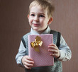 Little boy holding present