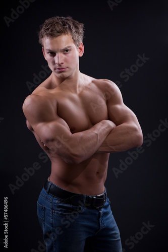 Muscle sexy naked young man posing in jeans
